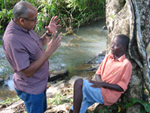 Erik Knudsen explains a shot to Kwasi by Birim river